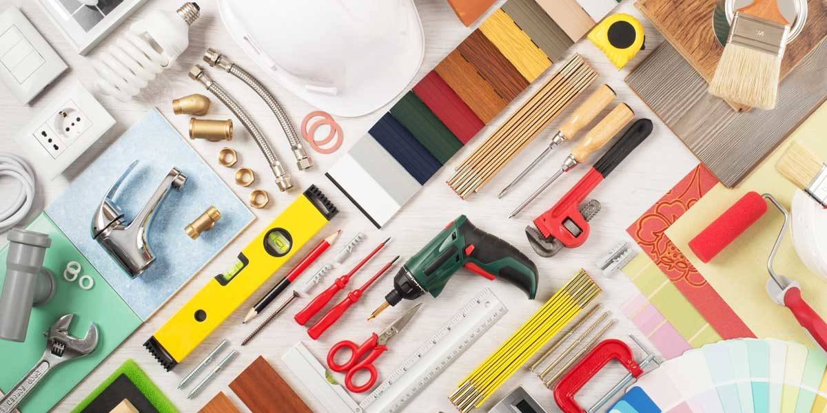 Collage of building materials and tools for how to hire a contractor for home renovations